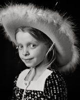 close up portrait of girl in cowboy hat