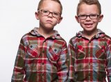 Twin Boys with glasses studio portrait