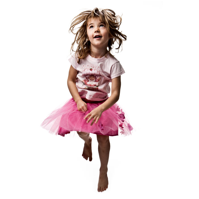 girl jumping pink clothes